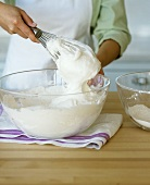 Beating egg white stiffly with a whisk