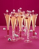 Eight glasses of champagne cocktail