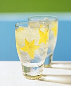 Two summer drinks on the rocks with star fruit