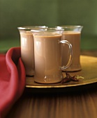 Three glass cups of hot chilli chocolate