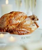 Roast turkey on festive table