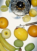Fruit (some peeled), vegetable peeler, lemon squeezer