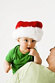Small boy in Father Christmas hat
