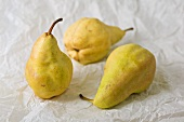 Three pears on greaseproof paper
