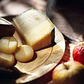 Various types of cheese on a wooden board for ploughman's