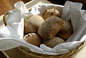 Rustic bread rolls in a basket