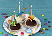 Three muffins on paper plate for child's birthday