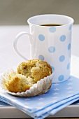 Banana muffin with a mug of coffee