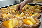 Putting fruit on Danish pastries