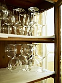 An assortment of wine glasses in a cabinet
