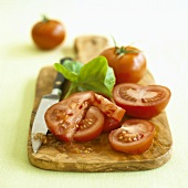 Sliced tomatoes with basil and knife