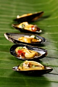 Mussels with sweet and sour sauce on a banana leaf