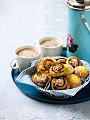 Basket of pastries and cocoa on tray