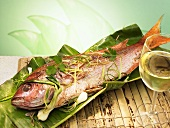 Red snapper on banana leaf