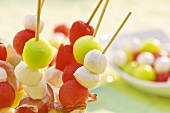 Melon balls and mozzarella on wooden skewers