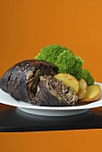 Beef roulade with roast potatoes and broccoli