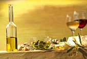 Still life with olive oil, olives and wine