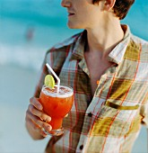 Young man with Singapore Sling