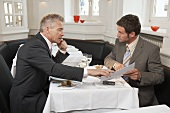 Two men in negotiations in a restaurant