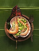 Prawns on avocado salsa in a shell