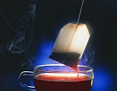 A cup of hot tea with a dripping tea bag