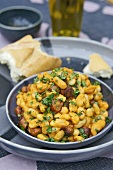 White beans with chorizo and coriander leaves