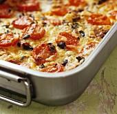 Potato and tomato bake in a roasting tin