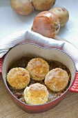 Lamb cobbler (lamb ragout with scone topping) in casserole