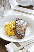 Sirloin steak with scrambled egg for brunch (USA)