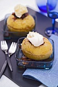 Two baked apples with raisins, nuts and cream