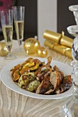 Pieces of Christmas goose with stuffing & root vegetables