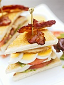 Two club sandwiches with bacon