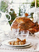 A roast turkey on a festive table