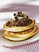 Two pancakes with chocolate cream