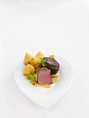 Venison medallions with cream sauce and potato croquettes