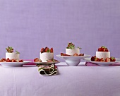Mascarpone cream moulds with strawberries on different plates