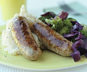 Fried sausages with mashed potato and broccoli