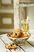 Oat biscuits with nuts and raisins in a small bowl