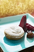 Chestnut tart with red wine pear