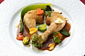 Roasted poussin legs with vegetables