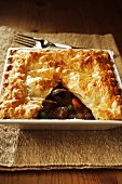 Venison pie with puff pastry crust