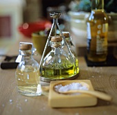 Olive oil, vinegar and sea salt on a wooden table