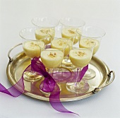 Seven glasses of advocaat on silver tray