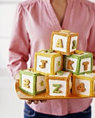 Cubes of cake decorated with letters and numbers (building bricks)