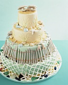 Four-tiered cake with beach-themed decorations