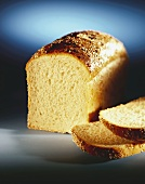 A Loaf of White Bread Partially Sliced