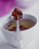 Rose Hip Tea in Cup and on Spoon