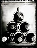 Wine bottles from Bordeaux in a wine rack (b/w positive)