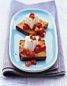 Toast with goat's cheese and diced tomatoes