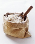 A Sack of Flour with Wooden Scoop